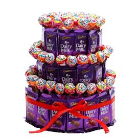 24 hrs online dairy milk n lollipops arrangement delivery in kanpur