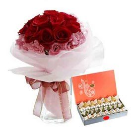 Buy online mix flower in vase n assorted kaju sweets in kanpur