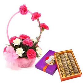 Send online half kg anjeer barfi n mix carnations basket in kanpur