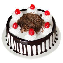 Buy online half kg black forest desire cake delivery in kanpur
