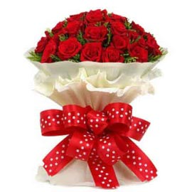 buy 50 red roses white paper bunch same day delivery in kanpur