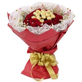 Send online ferrero rocher chocolates with red roses red paper n white net packing in kanpur