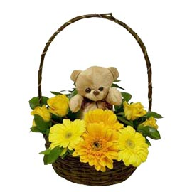Buy online yellow flowers n cute teddy arranged in basket delivery kanpur