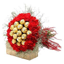Send online ferrero rocher chocolates n 20 red carnations in kanpur