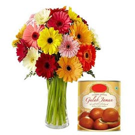 Send online gulab jamun pack n mix gerberas in vase kanpur