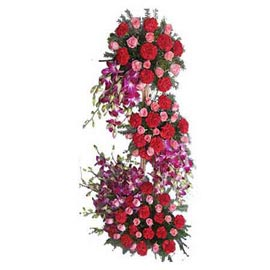 send carnations roses n orchids grand three tier basket fast delivery in kanpur