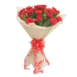 buy 15 red roses white paper bunch midnight delivery in kanpur