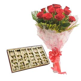 Midnight online Kaju pista roll n red roses bunch in kanpur