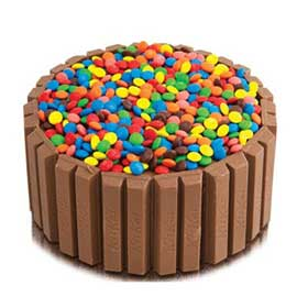 Send online half kg choco gems cake delivery in kanpur