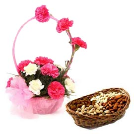 Send online Mix carnation n dry fruits in cane basket in kanpur