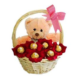 gift online cute teddy arranged in ferrero chocolate hamper basket in kanpur