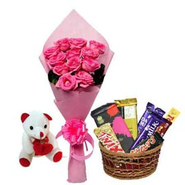 Same day online pink roses basket, assorted chocolates n cute teddy in kanpur