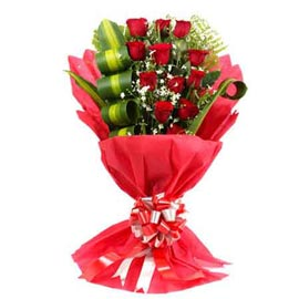 send 12 red roses red paper flat bunch urgent delivery in kanpur