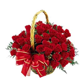 send 25 red roses cane basket express delivery in kanpur