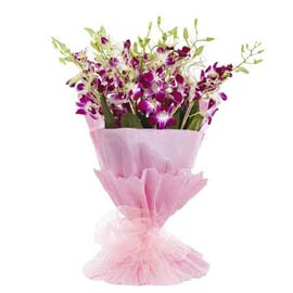 send 6 purple orchids pink paper bunch 24 hrs delivery in kanpur