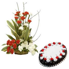Buy online black forest cake n mix carnations basket in kanpur