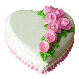 xpress delivery of 1 kg vanilla floral heart cake in Kanpur