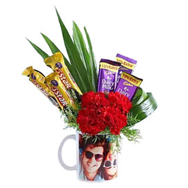 buy chocolates carnations in picture mug arrangment 24 hrs delivery in Kanpur