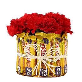 send chocolate n carnations glass arrangement morning delivery in kanpur