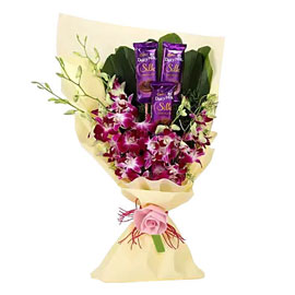 send chocolate n purple orchids Jute paper bunch urgent delivery in Kanpur
