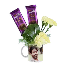 buy chocolaty carnations in personalised mug arrangment 24 hrs delivery in Kanpur
