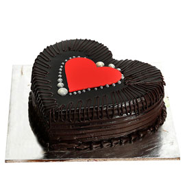Send online heart dark truffle cake delivery in kanpur