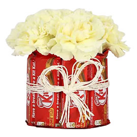 Send Kitkat Carnations Arrangement Same Day Delivery in Kanpur