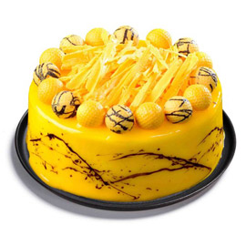 Midnight online Mango Truffle Cake delivery in Kanpur @ cake shop