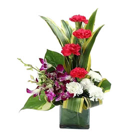 send mix carnations orchids vase arrangement same day delivery in kanpur