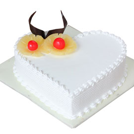 buy online half kg Pineapple heart cake delivery in kanpur