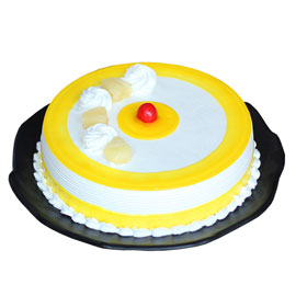 Send online half kg Premium Five Star Pineapple cake delivery in kanpur