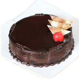 24 hrs delivery of half kg premium truffle cake delivery in kanpur
