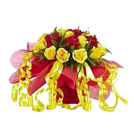 buy red n yellow roses vase arrangement 24 hrs delivery in Kanpur