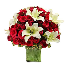 buy red roses n lilies in vase arrangement 24 hrs delivery in Kanpur