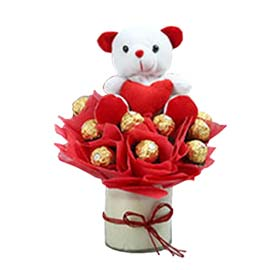 gift online cute teddy arranged in ferrero chocolate hamper vase in kanpur
