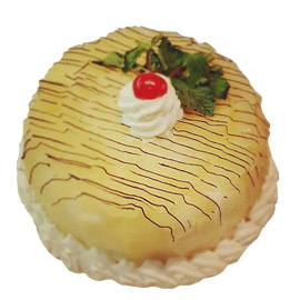 Send online half kg super premium pineapple cake delivery in kanpur